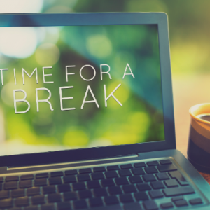 "laptop reads ""Time for a Break"" coffee next to laptop"